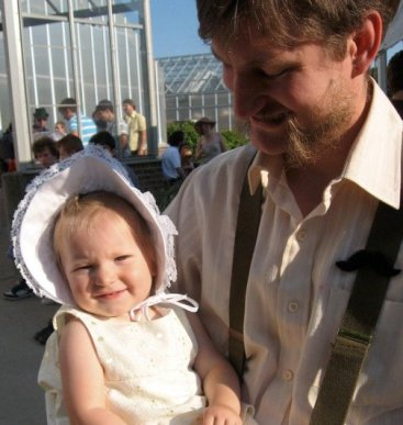 Dereck and his daughter dressed for dancing.